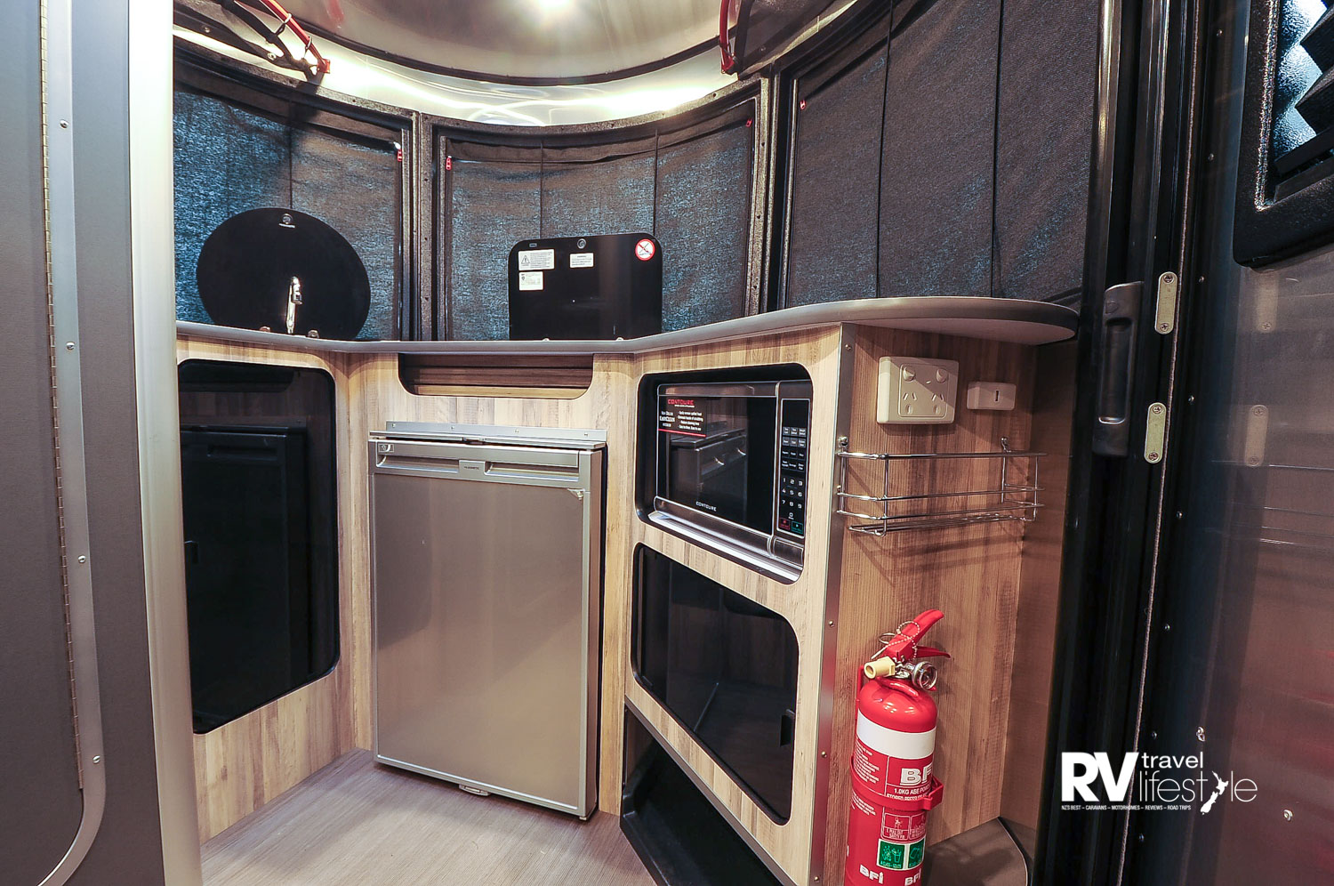 The kitchen in the nose has everything you need, microwave, fridge, two-burner gas hob, sink and storage areas