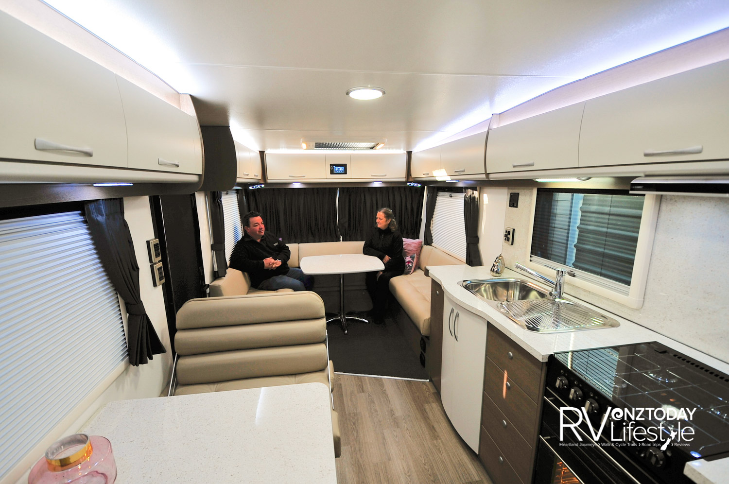 This is a spacious vehicle at nine metres, with an airy U-shaped rear lounge and a separate dinette area with a double facing seat – a great idea and use of seating space. There is carpet in the living area for warmth and comfort, but vinyl in the entrance and work space area as far as the bedroom. The leather upholstery is luxurious. The windows have fly-screens and pull-up shades, shades, these models are also fitted with quality curtains. A 24˝ Smart TV is also fitted in this area.