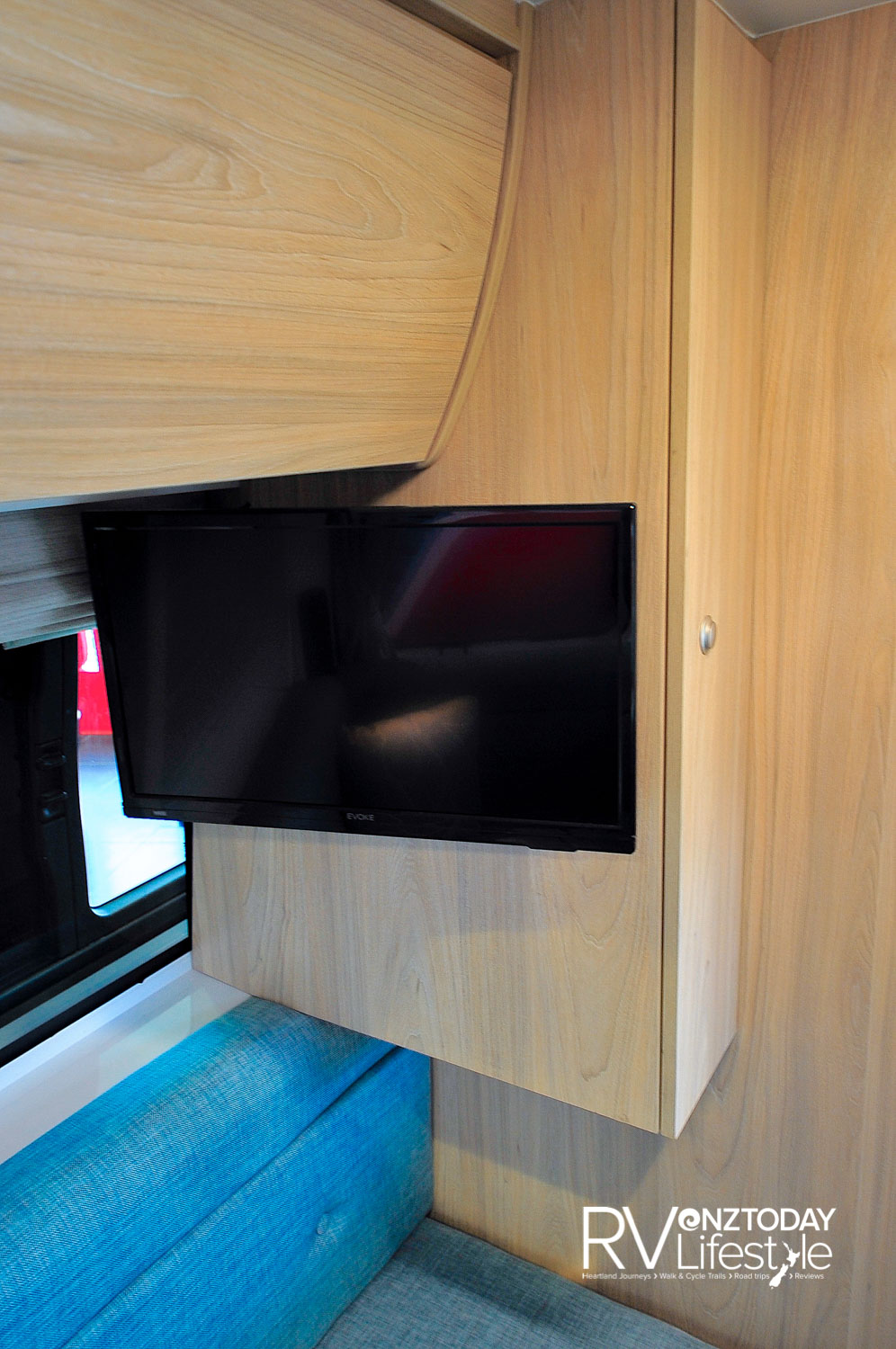 The 19″ Evoke TV is fixed to the cupboard wall on an adjustable arm for viewing