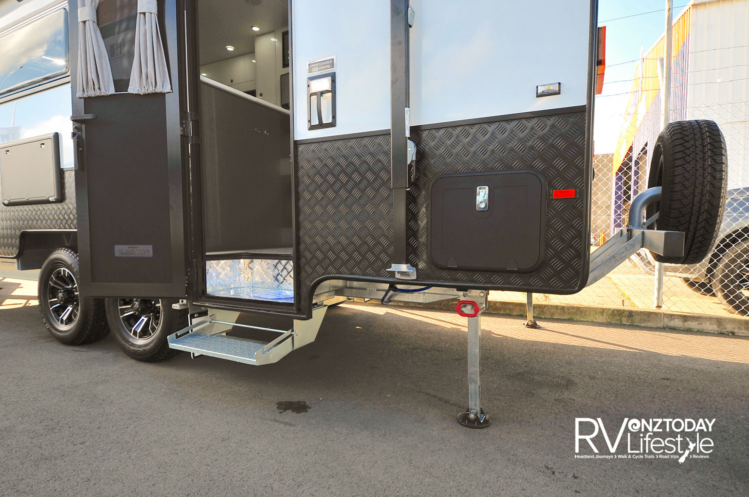Manual entry step-up to recessed internal step. Galvanised chassis on a twin-axle structure, sturdy stabilisers, grab handles with light for entry, strong side arms for the wind-out awning, aluminium sides make for a strong off-road package