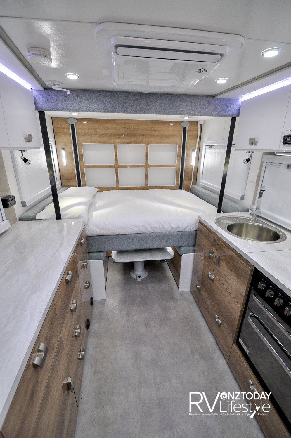 The rear ceiling electric bed comes right down to squab height, and lifts for entertainment use during the day