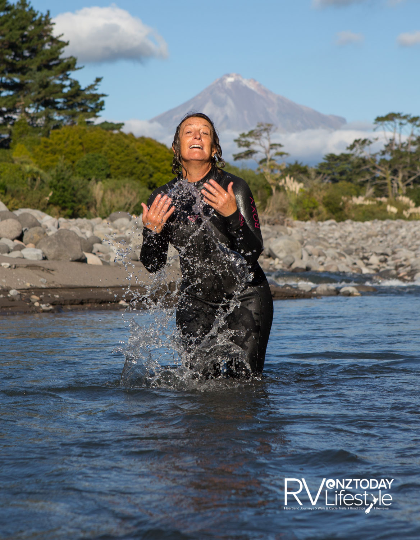 Nikkie Andrews enjoys an autumn swim near the Stony River bridge