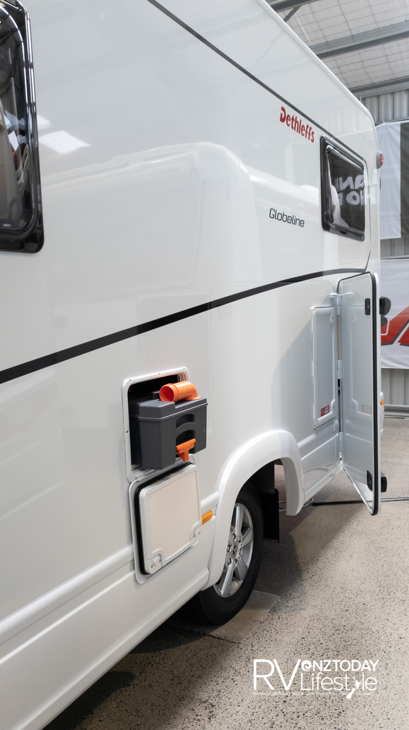 Gas and toilet service lockers on the kerb side of the vehicle