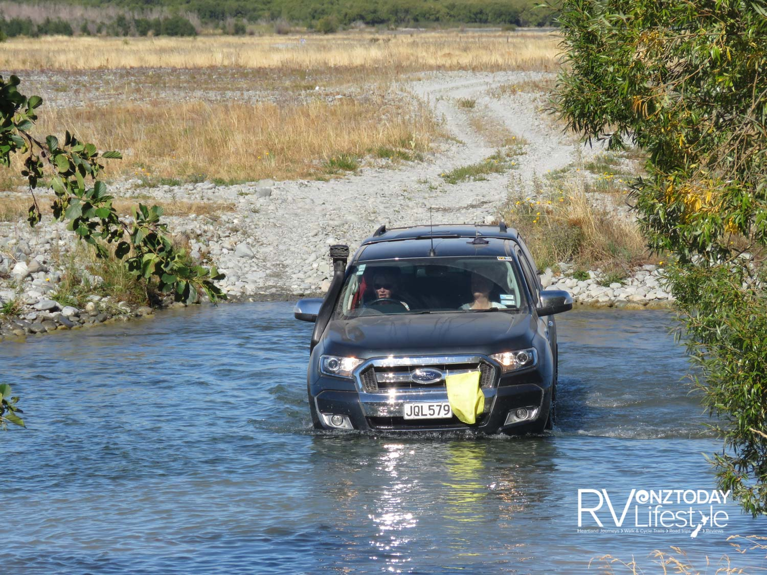 Women can do anything! Tail enders for the day, Ann and Jaquee Reid, driving through a river crossing