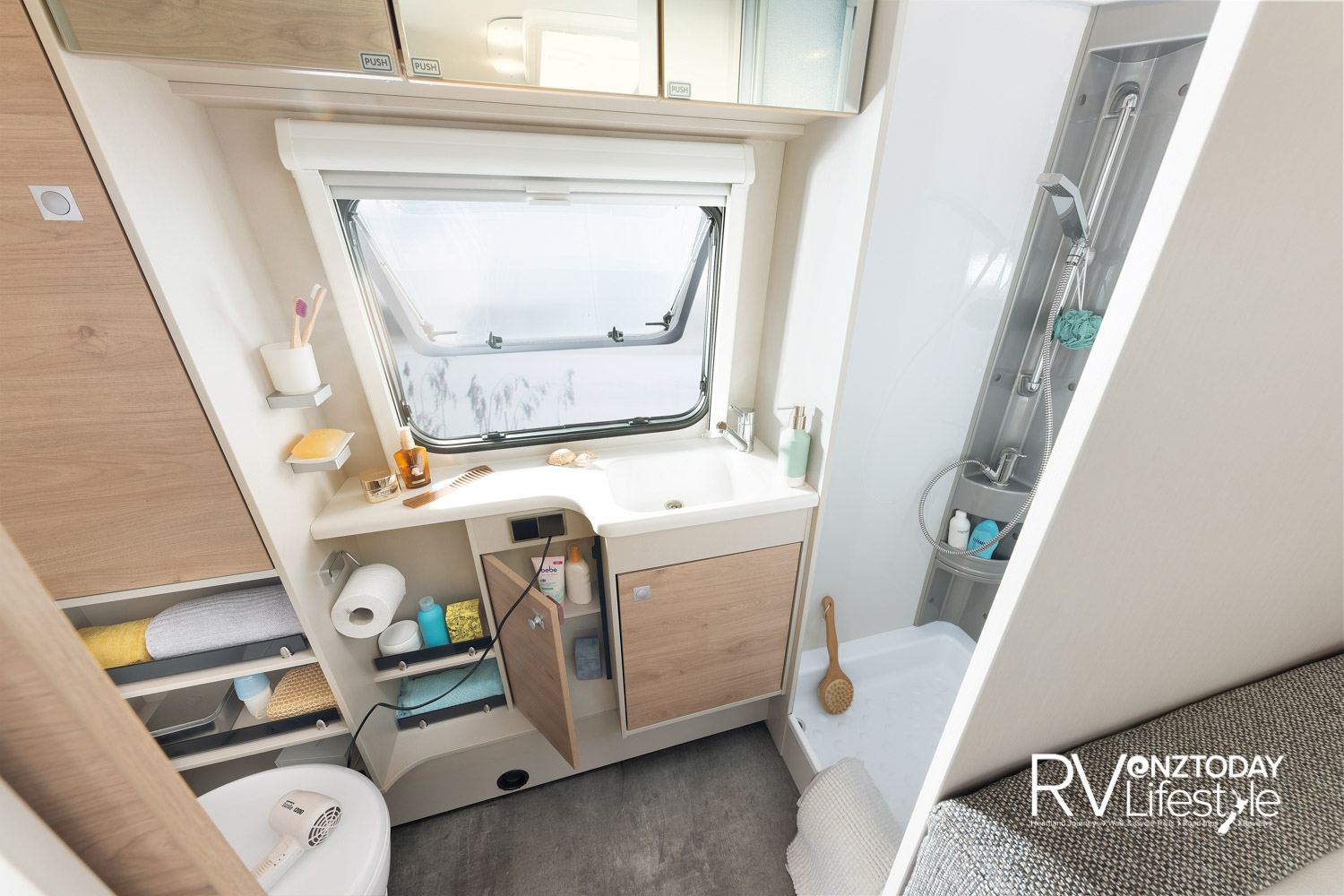 At the rear is the full-size bathroom with separate shower cubicle and premium vanity