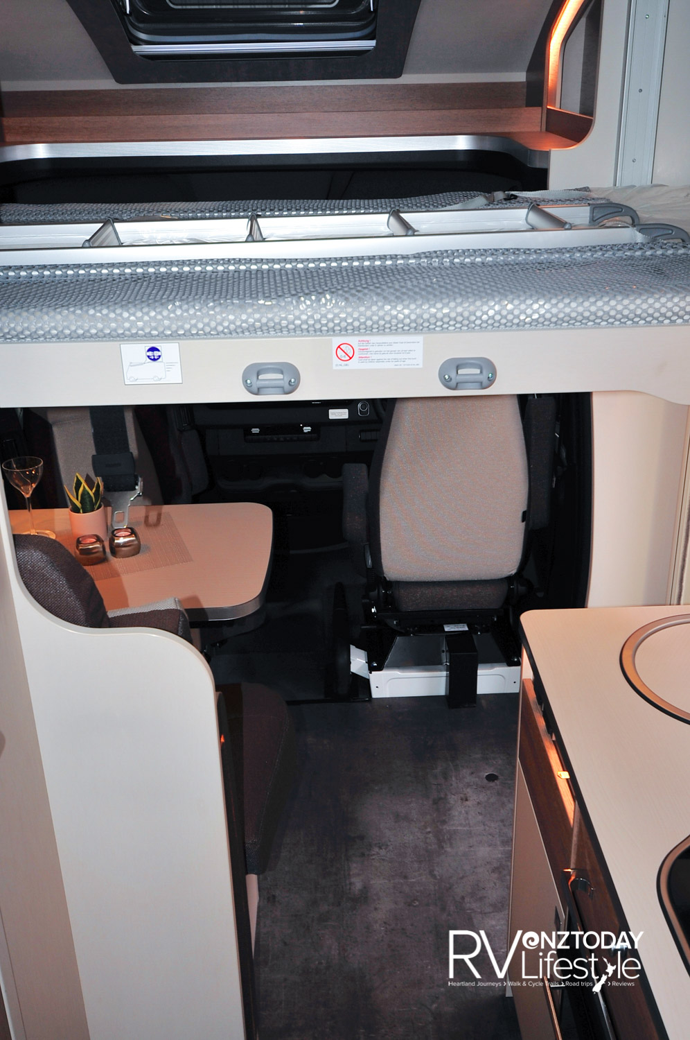 Electric drop-down bed over the dinette area, a single berth but good size at 2000 x 900mm. Open area above the cab in the luton, with storage pods and overhead roof vent