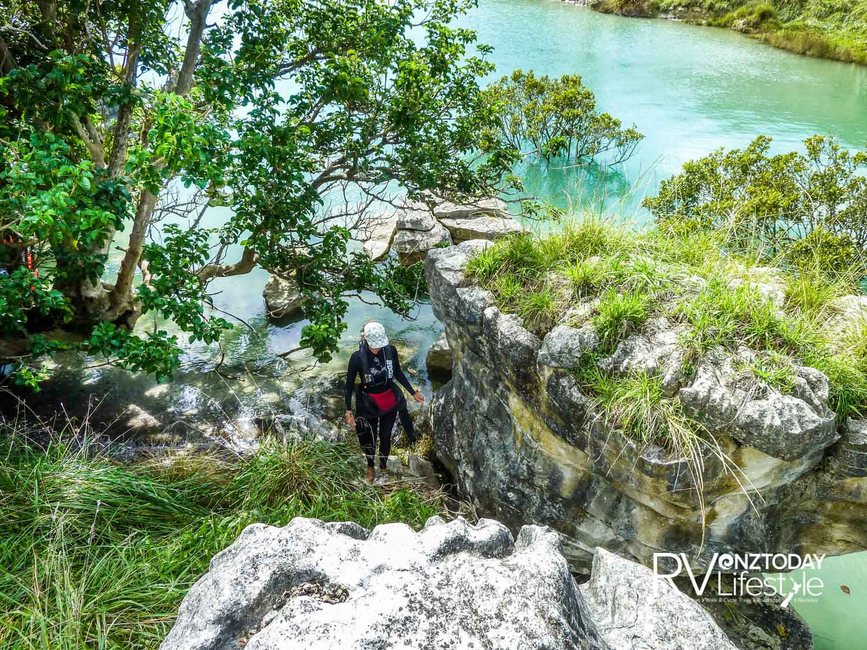 Justine climbing the Pancake Rocks at Tokatoka Point