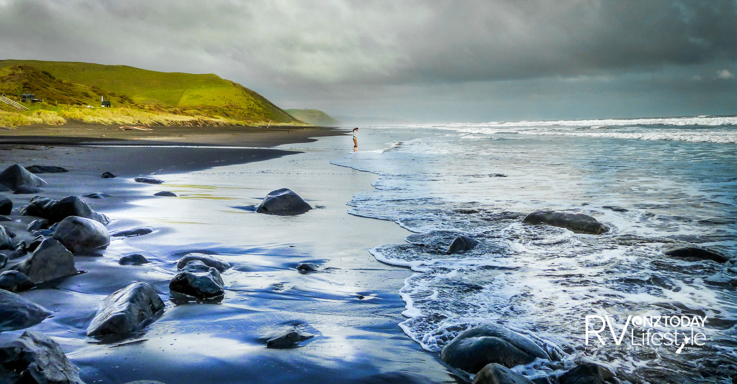 The jet black sands of Ruapuke Beach sparkle as if infused with fallen stars