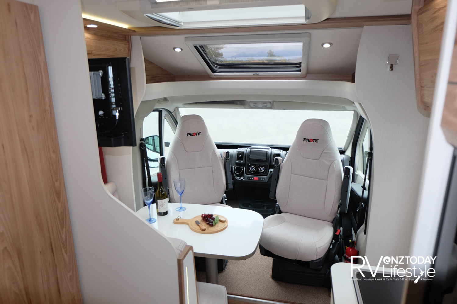 Swivel cab seats add to the seating options from the front cab area. Lots of light with the roof vents above