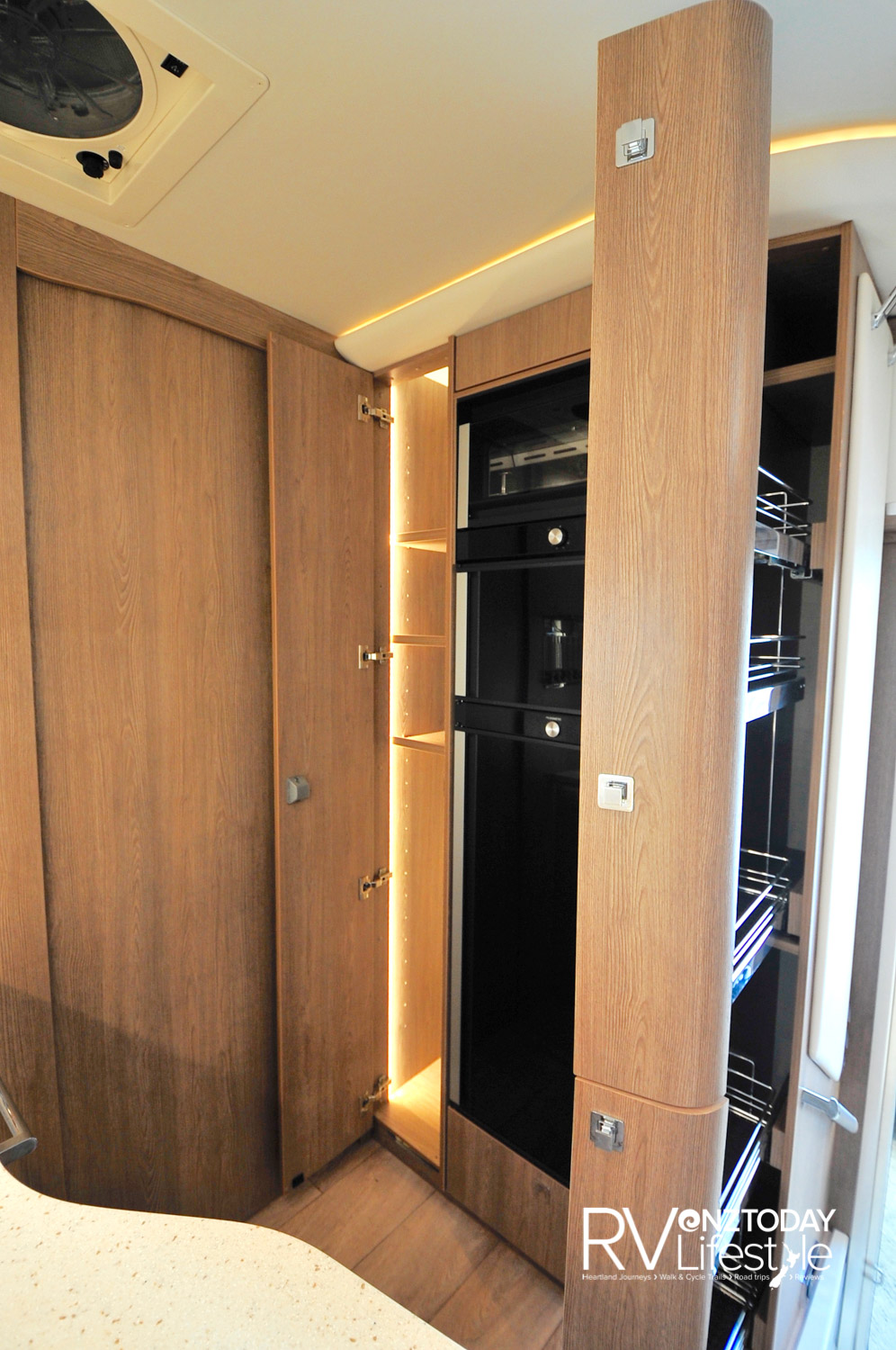 Full-height pantry split into two, double lock on the top one. Fridge with overhead grill unit and another storage or wardrobe unit to the left