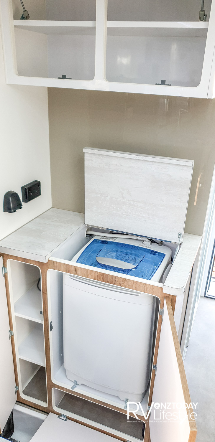 Washing machine – such a handy little unit, storage above and beside it, space on top – such a luxury
