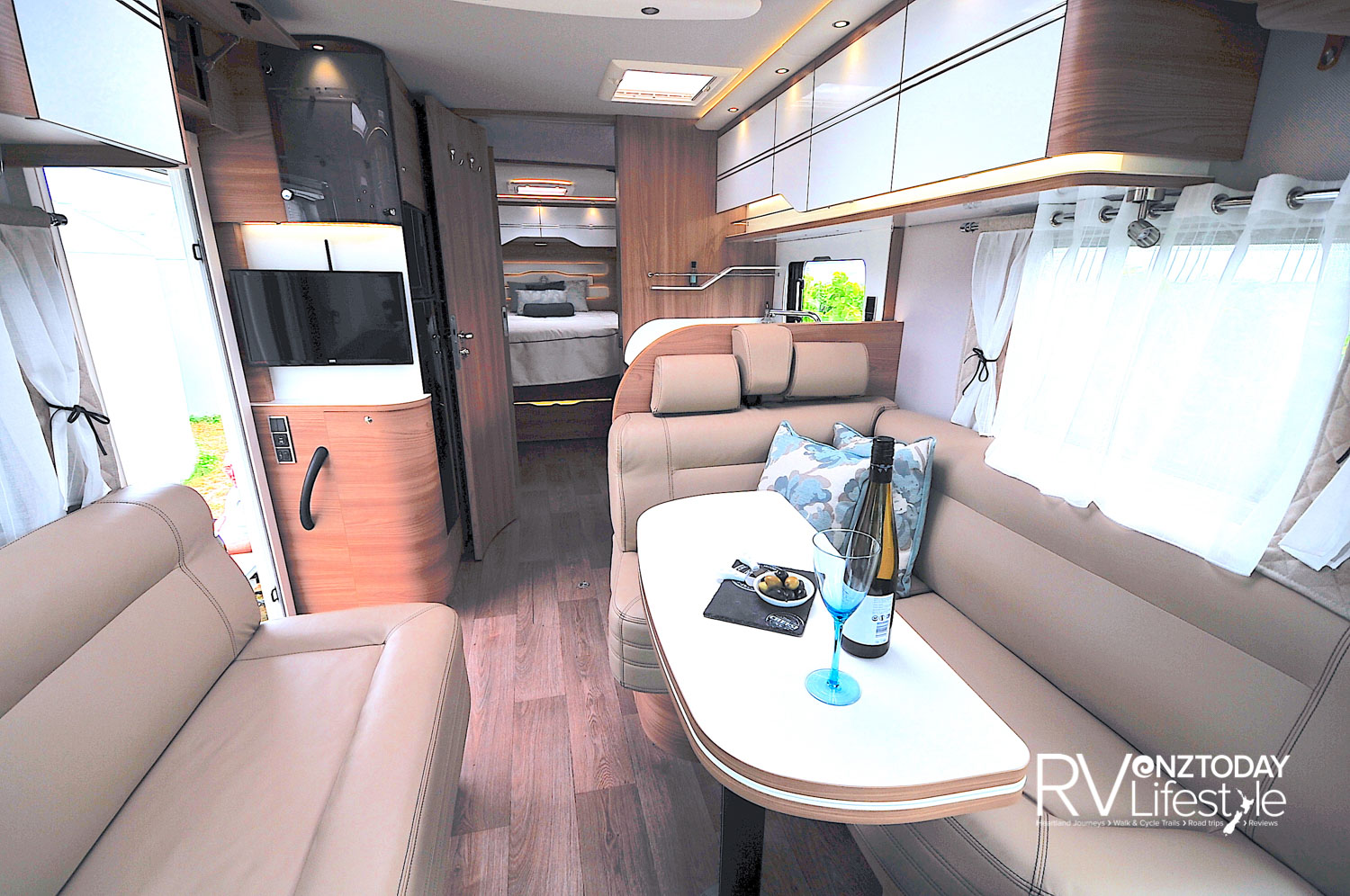 The long couches offer this area genuine feet-up relaxing comfort. The adjustable table is fantastic as well. Upon entry the TV is to the left, pull-out storage beneath, monitor cupboard above the door, a second lounge seating area between the driver's swivel cab seat and the habitation entry door
