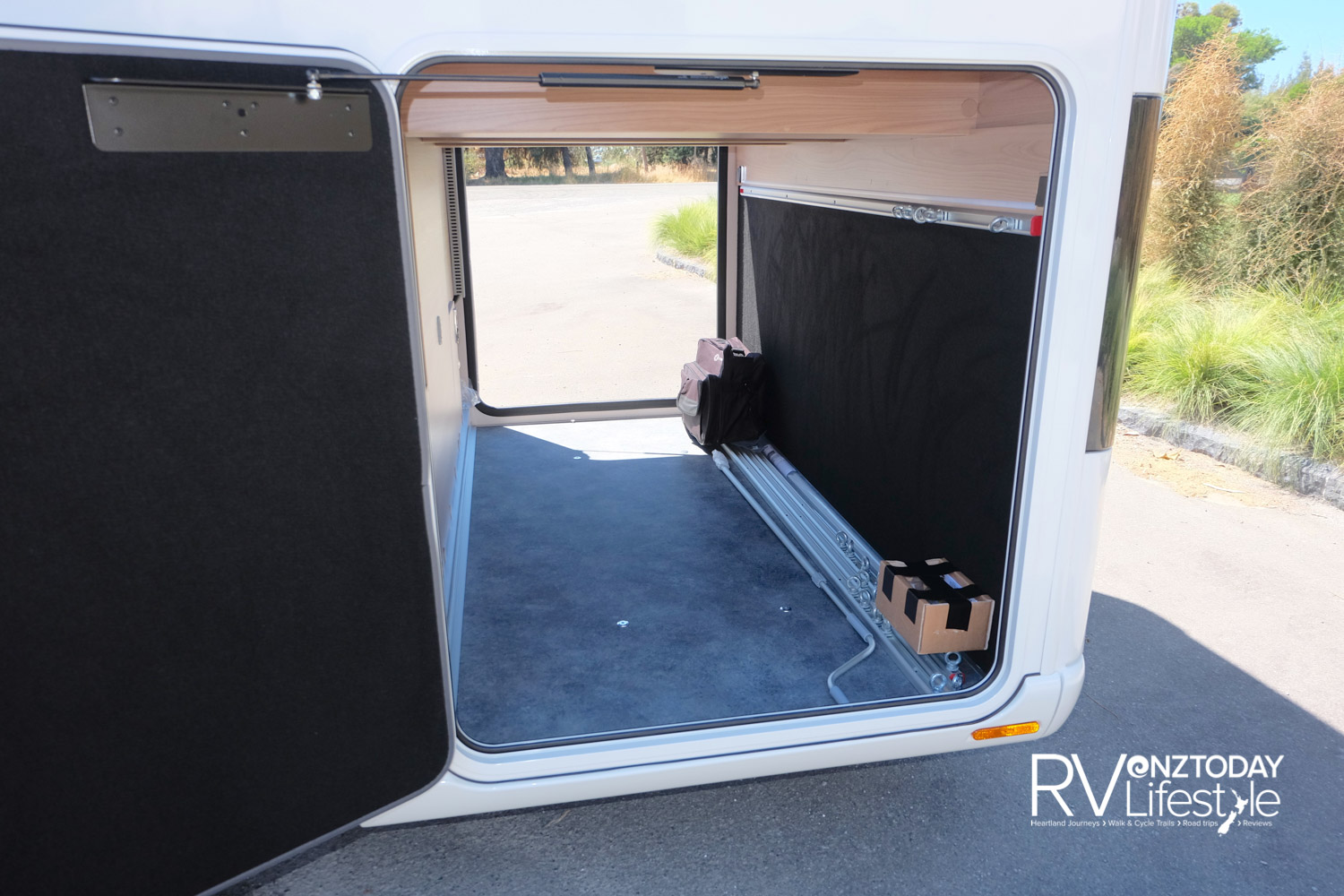 Large rear boot, accessible both sides, plenty of tie down positions, extra storage shelves and drawers as well