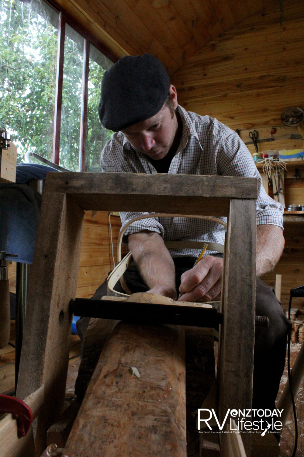 Seated at his special shaving horse, Tony begins assembling another trug (Photo: Lana Taylor)