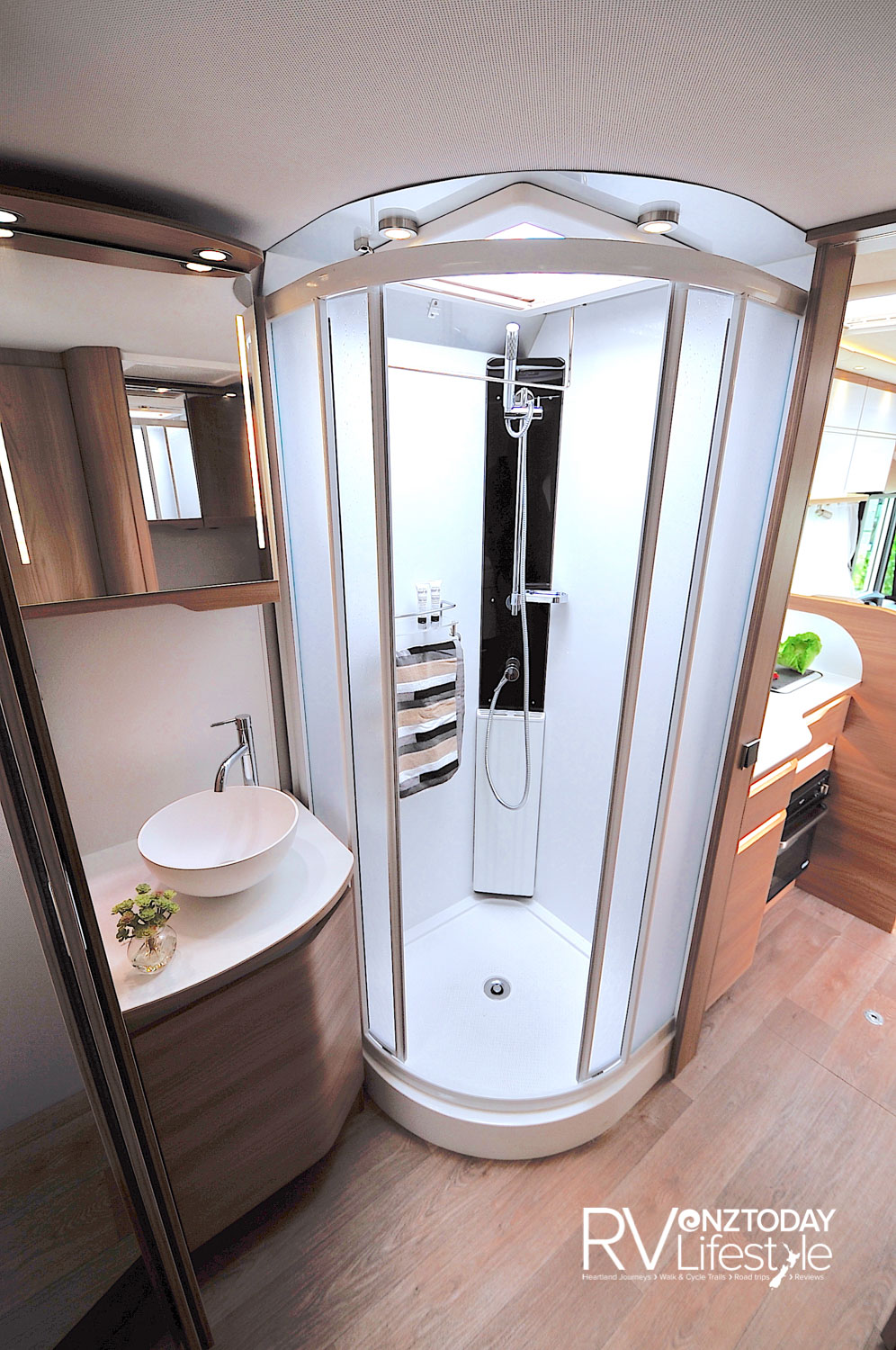 Full shower on the passenger side of the vehicle, en-suite toilet on the opposite side, walk through to the bedroom. Privacy doors to kitchen and bedroom zones