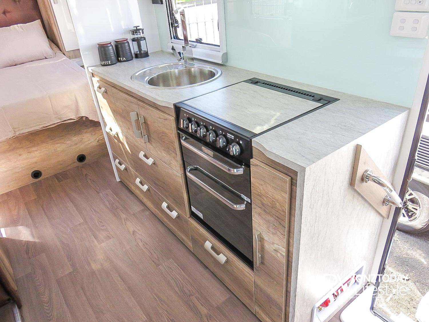Decent kitchen bench size, lots of under bench storage, pull-out pantry, drawers and cupboards. Round stainless-steel sink with small drainer, the full oven with separate grill, three gas and one electric hob – comes with a nice cover to expand bench space