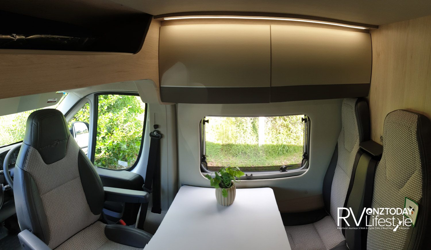 The front cab seats swivel for extra dining area seating, storage locker above the window. Plenty of light with large windows that have fitted fly screens and blinds, LED strip lighting all around. These front facing seats have fitted seatbelts