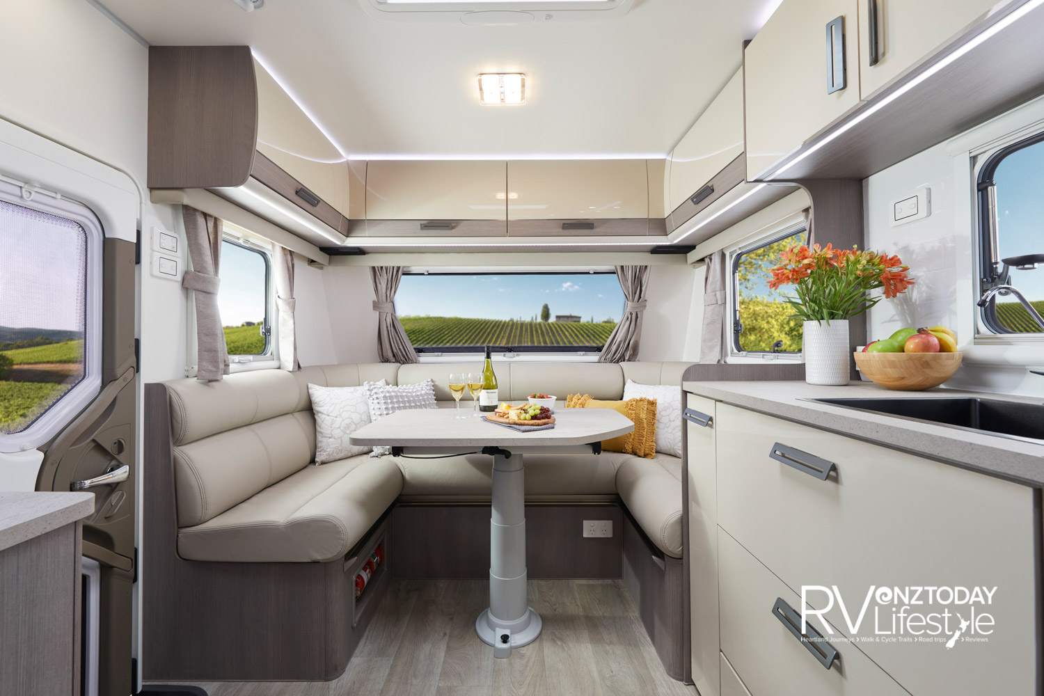 Really nice club lounge, fully height adjustable leg table. Overhead locker storage. The windows all have fly screens and blinds fitted, LED lighting throughout. The habitation entry door on the left has viewing window and screen split door action