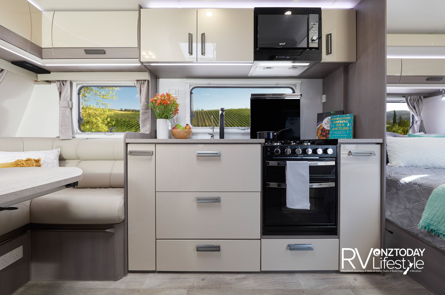 Upon entry you have the kitchen unit opposite, cupboards and microwave above, drawers and pull-out pantries below, full separate oven/grill oven with four-burner gas hob. Nice backsplash, big window and rangehood
