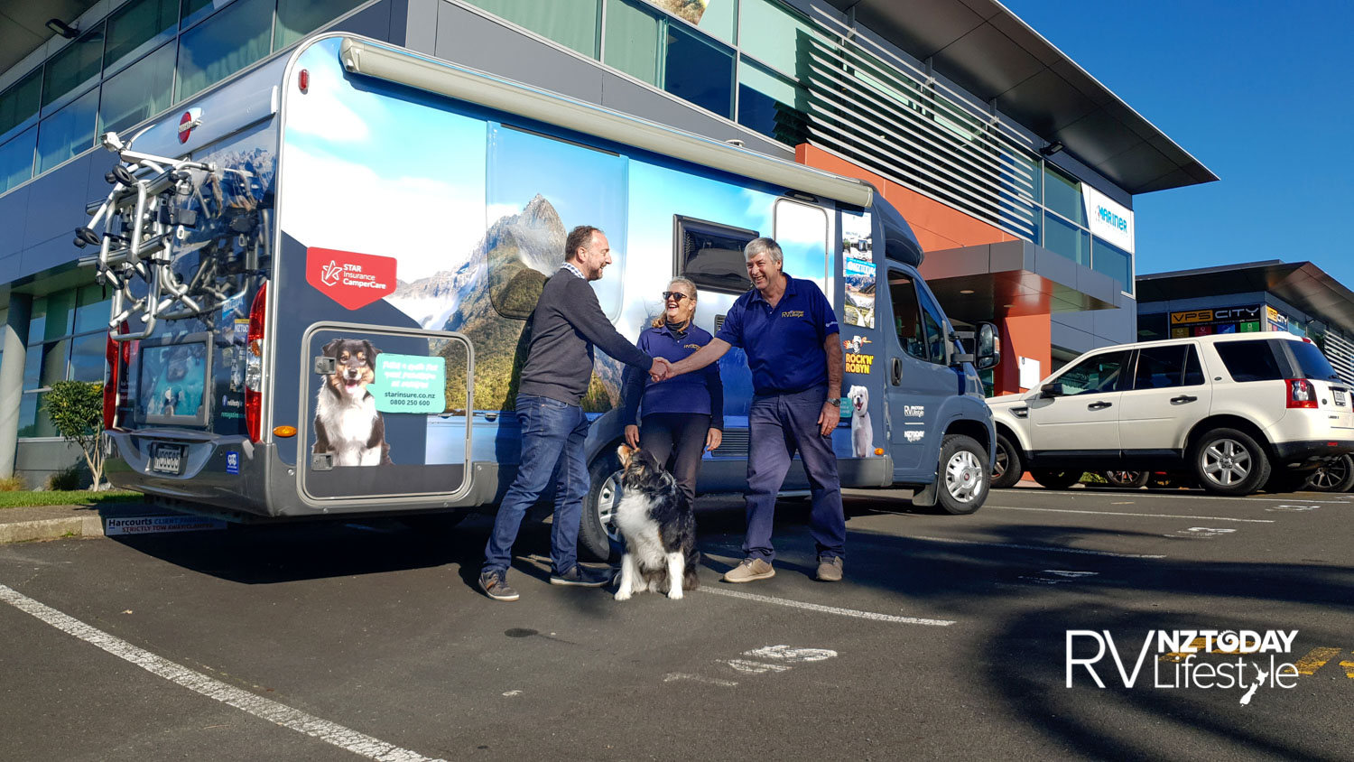 Nick Baker from Star Insurance, with Bailey the Camper Care Insurance mascot - Bruce and Robyn picking up the vehicle after graphic wrapping