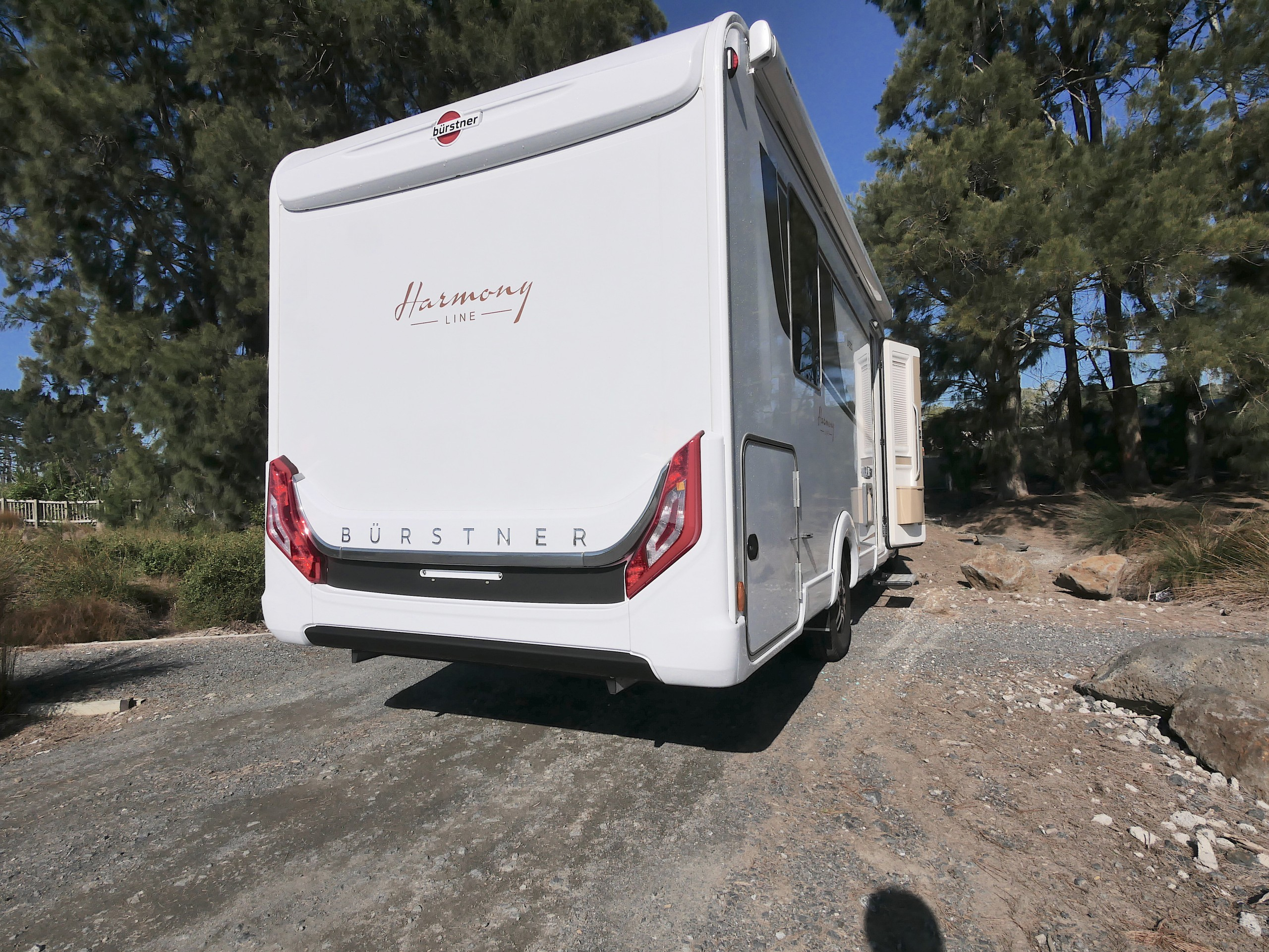 Exterior graphics offer style on the exterior, a near full-length awning is great, habitation door is on the right driver side, electric entry step