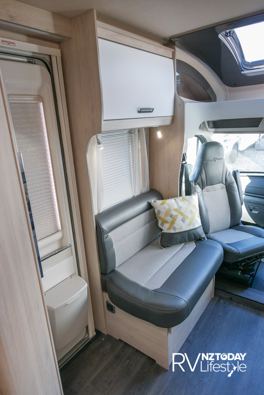 Habitation entry door is on the left behind the passenger for kerb-side entry. Side wall lounge seating with plenty of room for the removable table to go in – the only internal step is the small one into the cab. Cab Captain's seats that swivel and adjust for personal comfort adding more entertainment seating