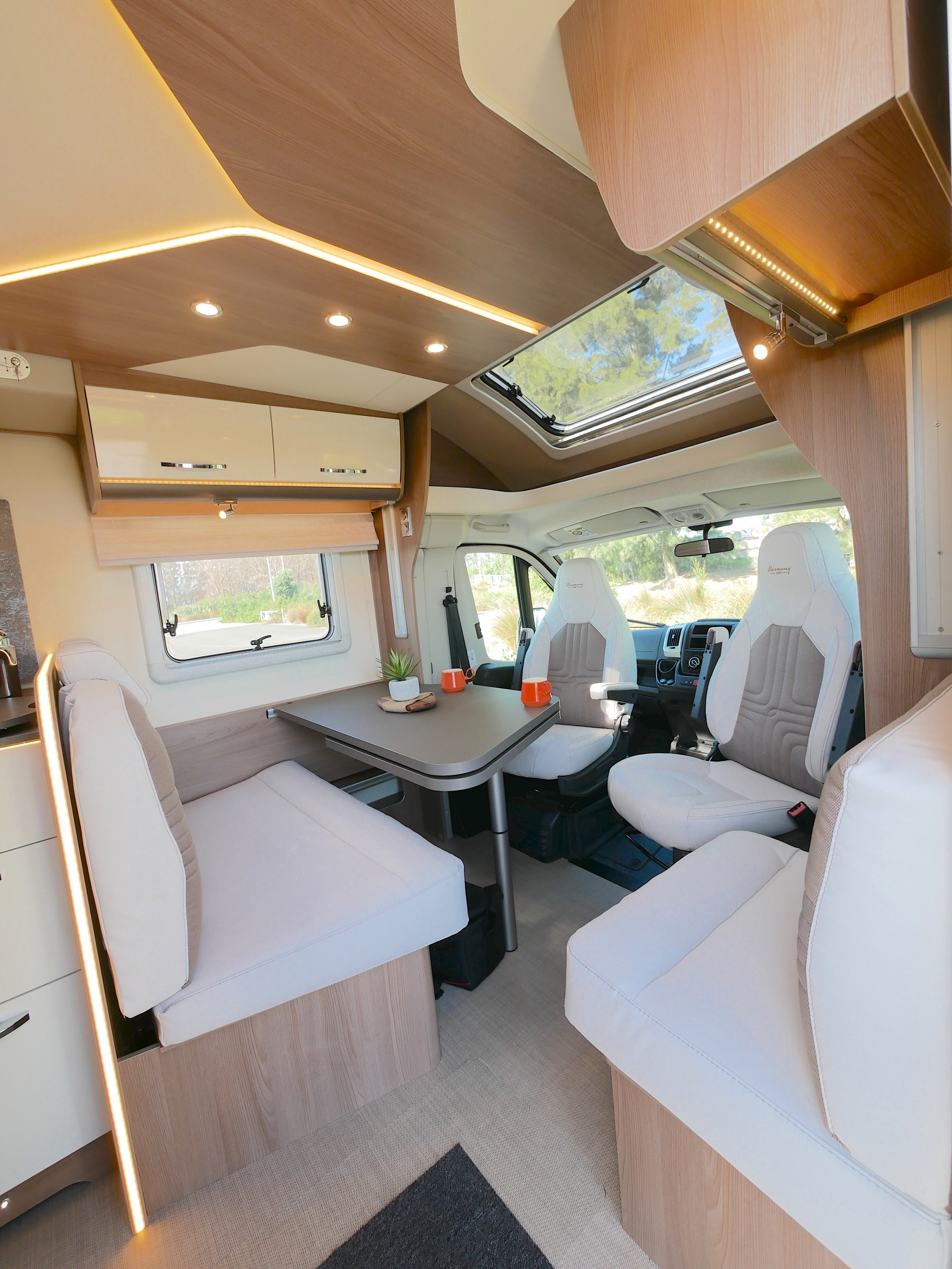 Stepping into the vehicle the lounge-dining area, swivel Captains chairs, and good-sized window. Plenty of LED lighting options as well