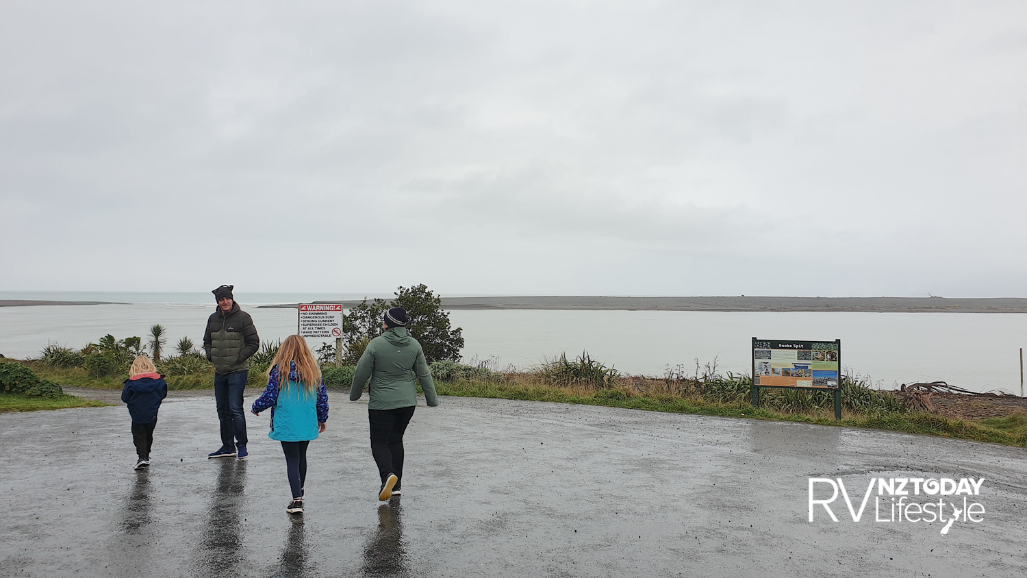 Lake Onoke or Lake Ferry, this family out for a brisk walk in the rain